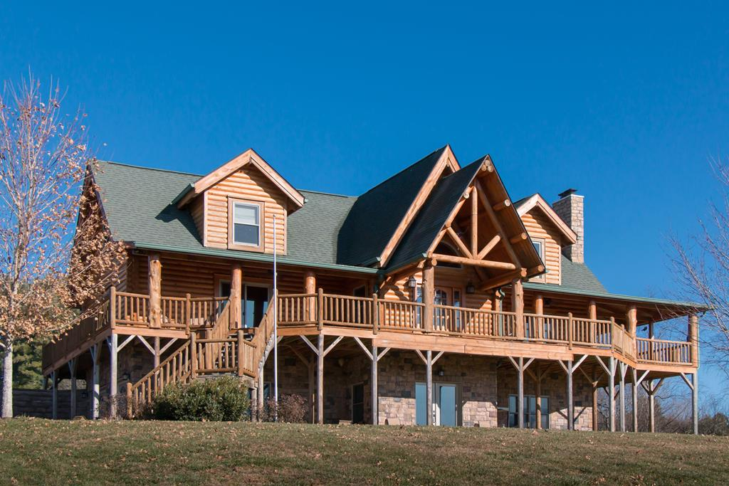 FABULOUS CUSTOM BUILT LOG HOME!!!!   Unbelievable views of the Holston Mountains.  As you enter this home you will experience wide open spaces accented by huge hemlock posts, soaring 18 foot vaulted and open beamed ceilings.  A two story stone fireplace offers a great place to cozy up to and read a book or visit with family and friends.  The kitchen boast of granite counter tops, custom cabinets and high in stainless appliances. Oversized first floor master suite with walk in closet, huge bath complete with built-ins and large walk in shower. Second floor offers an additional master suite with a loft study that overlooks the the first floor.  Lower level features a third bedroom suite and private den.  The additional space in the lower level has a spacious work shop and lots of storage, plus a two car garage. Outside you will find multiple decks with breathtaking views.  Great location!!  Just 2 minutes to public lake access and 10 minutes to beautiful historic Abingdon or I-81.