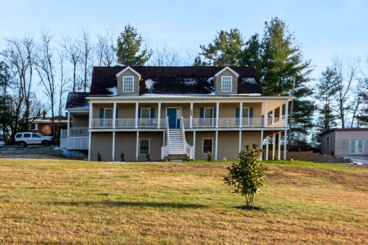 "Built in 2005 is this LIKE NEW & Remodeled Cape Cod home on 1.42 acres. Total of 4,120 SF w/4 LARGE BR's, 3.5 Baths, Formal LR & DR. Equipped w/ Handicapped ramp & 2nd Master Bedroom Suite on Main Level with 8.42 x 3.83 Walk-In Ceramic Tile Shower. Loaded with Extras you will love - Cherry Kitchen Cabinets/Brazalian Tigerwood Hardwood Floors, Porcelain Ceramic Tile floors,& Rinnai Tankless Propane Water Heater. 3 Heat Pumps zoned for Main Level, Upper, & 2nd Master BR Suite addition. The unfinished basement is plumbed for 4th Bath & offers limitless possibilities for expansion. Plenty of room in the detached 60'x15.75' Workshop & Storage Building w/Concrete Floor & Elect. Another 40' x 9'10"" storage area w/dirt floor. Enjoy the views from decks& bring your rocking chairs as multiple 3 sided deck on main level plus front & right side of Basement level. Upstairs is 23.58 x 5.75 room used as Hobby Room with Built-in Counter & Drawers. BR# 3 - Door to private deck 15.75x7. 25."