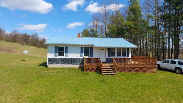 Ranch Style home with full unfinished basement with walk-outlocated in Patrick County, VA (5671 Jeb Stuart Hwy, Meadows of Dan, VA 24121). 3 bedroom, 1 bath, living room and kitchen dining area. Front deck (8' x 23'). Back deck off of kitchen (8' x 32). Deck is L shaped around the home. Re-modeled by present owners in 2018-2019.8.55 acres of land mostly rolling pasture land with a small portion being wooded. Views of the surrounding mountains. Big Ivy Creek crosses the North East Boundary of the property. There is a long private drive leading to the home from paved Route 58. Abundant wildlife - hunting. No restrictions. Survey. Most of the furnishings with stay with the home. (Call listing agent for list). Shown by appointment only