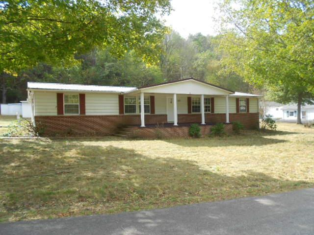 ADDRESS ALSO SHOWS AS 210 WILLIAMS STREET, RICH CREEK.  ACREAGE IS ESTIMATE.  BUYER TO VERIFY.  3 BEDROOM 2 BATH HOME FEATURING FIREPLACE, COVERED PORCH, OUTBUILDINGS, PATIO AND LARGE ROOMS.  CLOSE TO WVA LINE.  ALUMINUM SIDING ON HOME.  BUYER/BUYER'S AGENT TO VERIFY INTERNET AVAILABILITY.
