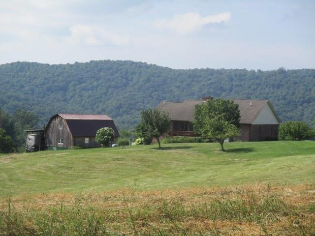 Elk Creek Valley-36.36 acres and brick Ranch Home.  The complete package.  Ranch home is in very good condition and full unfinished basement.  Most of the land lays well and open, field.  This property would provide most buyer requirements for a complete country lifestyle.