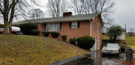 Back on the market with an improved price! Brick ranch in town limits on .4 acres. New roof. Some carpet has been pulled out. Hardwood under some of the carpet.