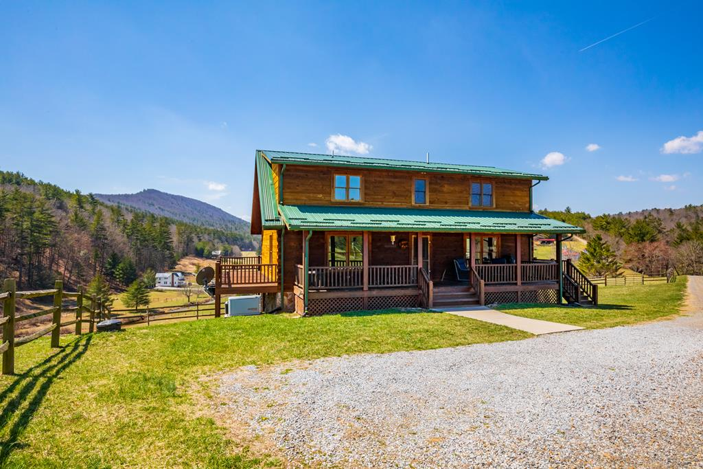 Live where equestrians come from all over to ride! You will have access to hundreds of miles of trails directly from the property, including the VA Highlands Horse Trail. It is truly an outdoor enthusiasts dream. Live in an immaculate 3,000+ square foot log home that offers great views from the wrap around deck. Other offerings include Generac Generator, a 4 stall barn with power, enclosed tack room with stairs leading to the huge hay loft. All of this sits on 10 acres, completely fenced, bordering Jefferson National Forest with year round bold stream for your livestock. Schedule a showing today!