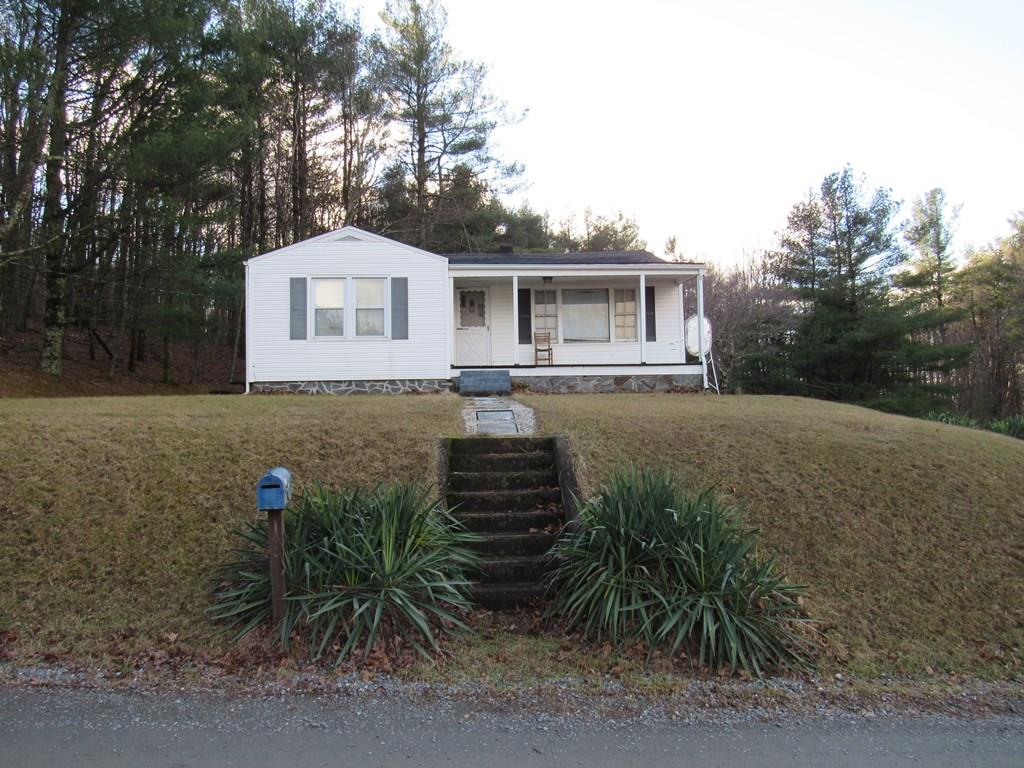 Located a stones throw from the Blue Ridge Parkway, this charming cottage is the perfect Fixer Upper for one looking to have a mountain retreat, or Airbnb, or just downsizing to a smaller place. The house has original hardwood floors in the bedrooms and likely has the same genuine floors beneath the Living room and foyer carpets, and beneath the kitchen vinyl. The house boasts a full basement, with an oil furnace for a very warm heat. The windows have been upgraded. The trendier architectural shingles are on the roof. The kitchen is really spacious to enjoy cooking and family gatherings, as well as the rest of the rooms. The Living Room has a huge picture window that brings one a beautiful view of the Blue Ridge mountains. When family visits your mountain home, but you