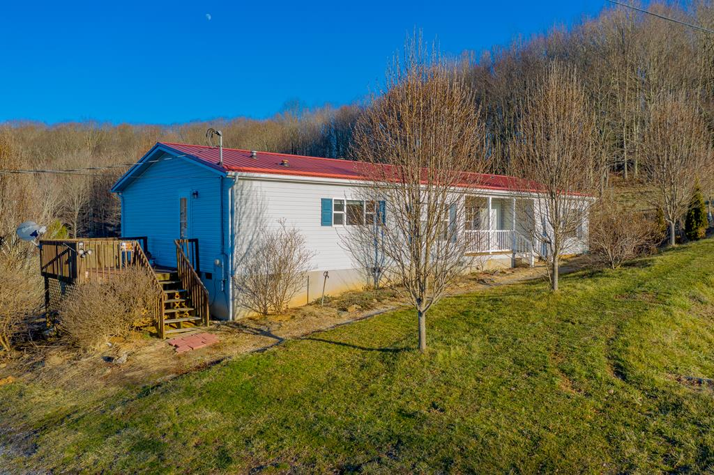 Looking for a view on a budget? Checkout the beautiful scenery from the back deck of your porch, while still being two miles from I-77, just minutes from the town of Bland, and 20 minutes to the town of Wytheville. With 1515 square feet, 3 beds, 2 baths and a spacious open floor plan, as well as a roomy master suite with his and hers vanity, there's enough room for all of your needs. Less than 14 years old, enjoy low maintenance living with a heat pump to keep you cool through the sunny summers and warm during the beautiful winters, with a corner fireplace to cozy up next to. See what not just this property but the rural living has to offer with National Forest and recreational opportunities just minutes away. With all appliances included and the possibility to purchase fully furnished, this home is truly move in ready. Schedule your private showing today and see what all this nearly 2 acre property has to offer! Current owner loves the home and area, but is needing to relocate.