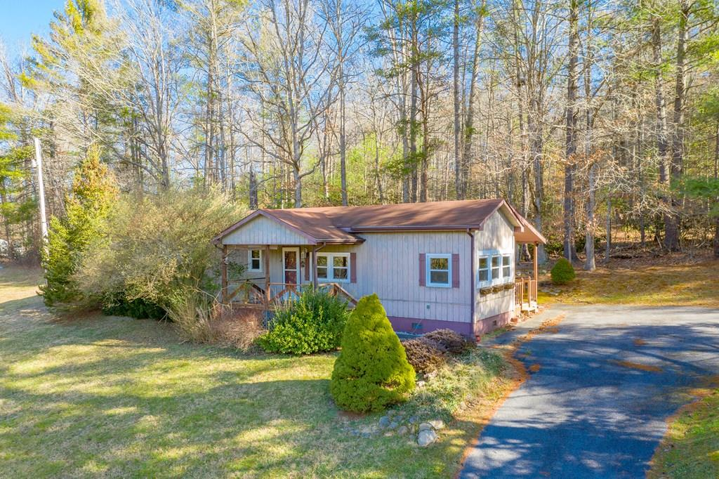"""Quaint and comfortable! This home is in a rural agricultural setting with a large delightful one and a half acre yard.  You have privacy and a cozy place to call home.  This home has lots of updates: double paned windows, both storm doors are new and the appliances were put in in 2017.  A """"State of the Art"""" water treatment system was put in in 2018.  With hardwood floors in the two living areas this house is hard to beat!!  Make an appointment to see this charming welcoming home today!"""