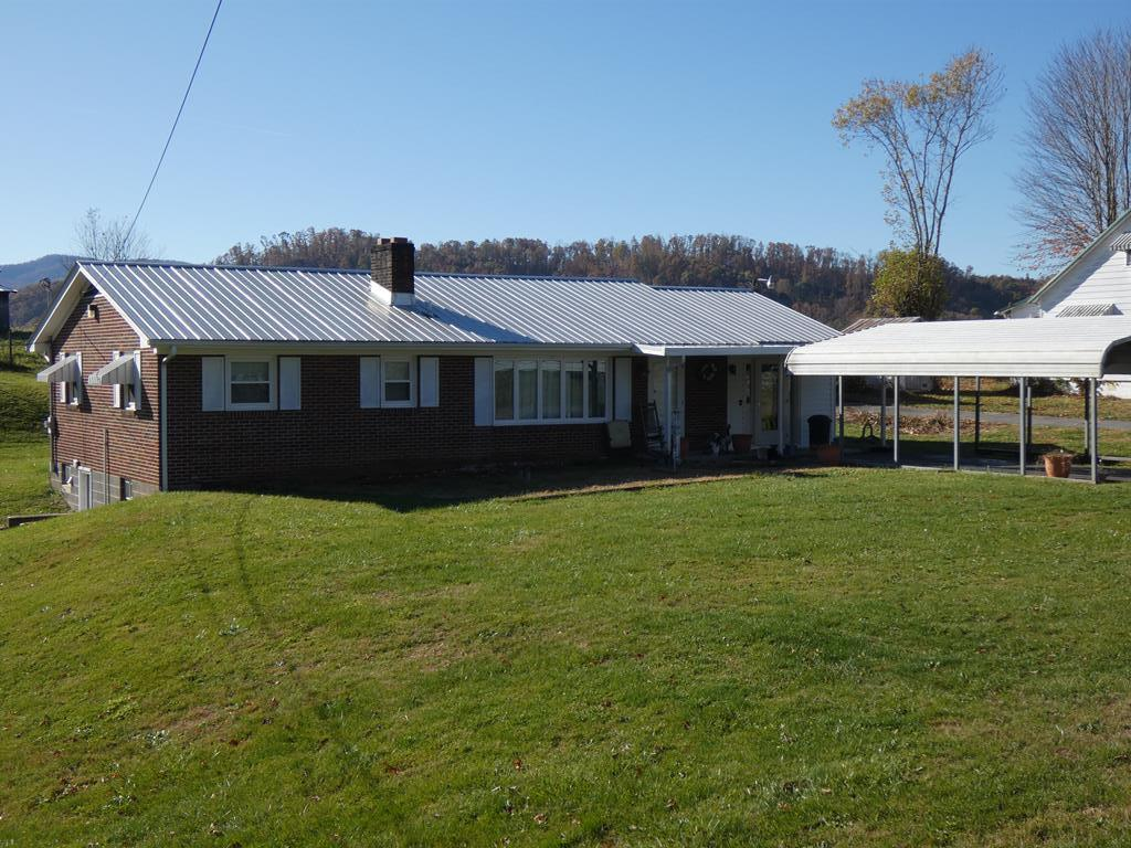 ENJOY PEACEFUL COUNTRY LIVING IN THIS ONE OWNER, ONE LEVEL CUSTOM BUILT BRICK HOME FEATURING THREE BEDROOMS, TWO BATHS, HARDWOOD FLOORS, WOOD BURNING FIREPLACE, AND FULL BASEMENT WITH WOOD STOVE.