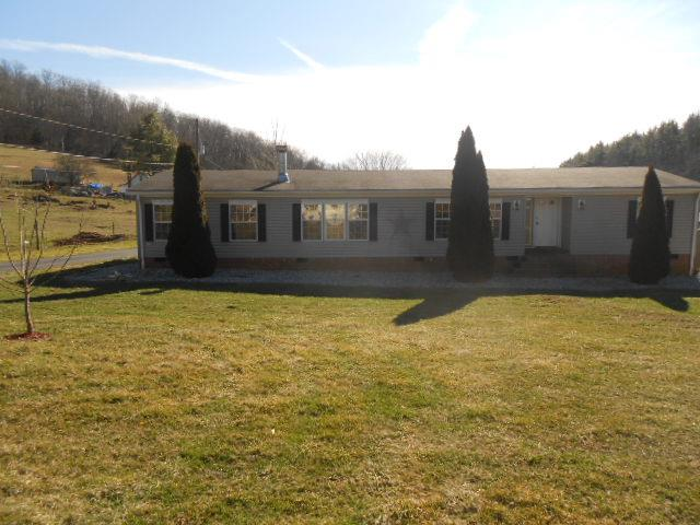 3 BEDROOM, 2 BATH, 1872 SQ. FT. SPACIOUS HOME FEATURING: HEAT PUMP, FIREPLACE, SOME FENCING, OUTBUILDING, FLAT & LEVEL 0.82 ACRES.