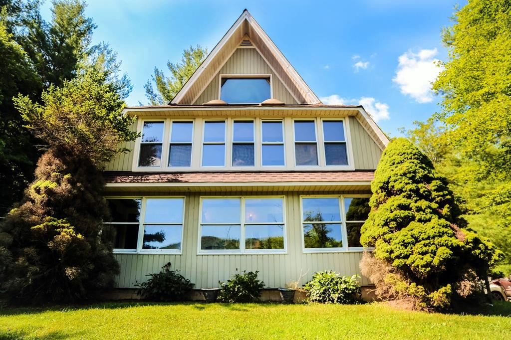 OFFERING A $3,000 CARPET ALLOWANCE WITH AN ACCEPTABLE OFFER...DONT LET THIS ONE GET AWAY!!!  Unique and Spacious A-Frame located in Chilhowie school district.  This 3BR-2BA home offers a loft room which could be used as a 4th bedroom - a studio - or an awesome play room.  The open floor plan has a sunroom on the main level and another on the second level to enjoy the natural light.  Check out the vaulted ceilings and the wooden beams.  There is a stone gas log fireplace to snuggle up by on those cold winter days & nights and enjoy privacy on your back porch during the warm days and nights.  Come see this one before its gone.
