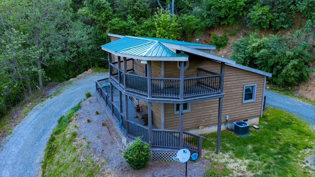 """Gorgeous Cabin on the New River ! Open floor plan, 2+ bedrooms, sellers have a third bed sleeping area in the upper loft. Enjoy your own New River waterfront lot that is included with this cabin and acreage. Live the life everyone dreams of with """"we are always on vacation here in the Blue Ridge Mountains"""". Privacy, seclusion and move-in ready perfect for full-time living or that second Blue Ridge Mountain get-a-way. Enjoy the New River in all 4 seasons. Relax under the canopy/lean to at the River's edge, add a firepit, some Adirondack chairs, have your friends bring their campers and experience the good life. The cabin has 2 large bathrooms, 1 up and 1 down. The full double walk-in rainfall shower is fabulous on the main floor along with the master bedroom. Upstairs you will find the second & third sleeping areas, a TV/home office area, sprawling half bath w/closet. Stunning views from the second level deck that overlooks the New River and mountain views. Gas log fireplace, 8x10 shed."""