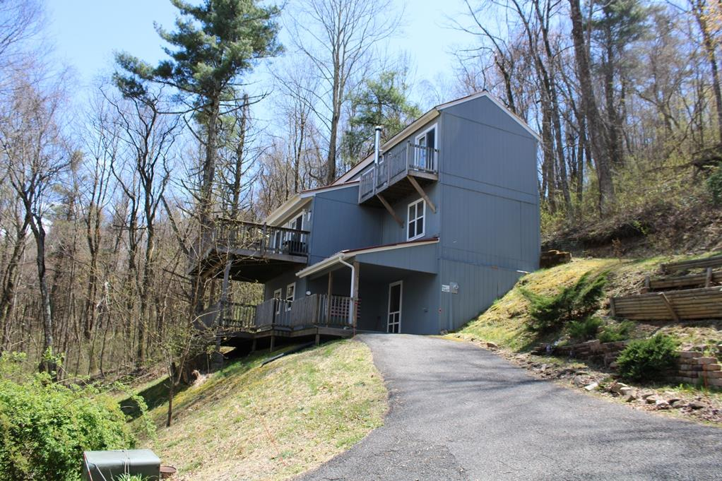Hillside Design Home located only 2 miles to I-77 and Hwy 52. Home features: 2 BR, 2 BA, 1250 sq. ft, 725 unfinished on the lower level which could be easily finished, 2 x 6 insulated exterior walls, Maple hardwood flooring and tile in the bathrooms, 10' x 20' deck off the living room, Wood burning stove, Nice pantry in the kitchen, Master bedroom has another deck for long range views in the winter time, Spacious loft with closet which could be turned into another bedroom and this home Comes Furnished. Exterior features: 3 levels of decks, Ondura roof, Smart Panel siding, Outbuilding with power, Underground power, Located on a private drive. You also have an observation deck that you can see the town of Hillsville. Very Private. Don't miss looking at this home. Great Price!