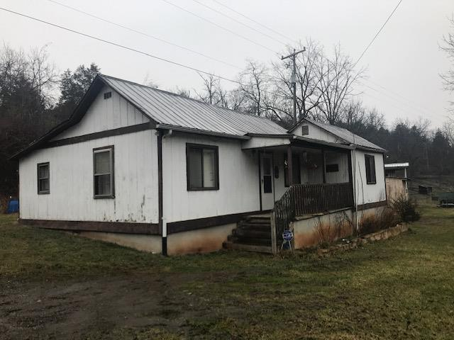 This 3 bedroom, 1 bath cottage sits on 1.75 acres with multiple outbuildings and some fencing.  Inside you have a large eat in kitchen, lots of built ins in the living room and a separate laundry room. This property has creek frontage and would make a good little gentleman's farm.  Call today for more information.