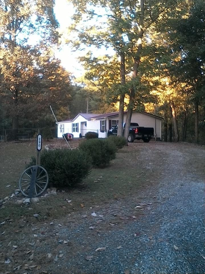 Beautiful move in ready 3BD/2BA on 6 acres of privacy with a creek. This home has been well taken care of with many updates including newer heat pump, metal roof, newer laminate flooring, stainless steel appliances, and more. Spacious living room with stone gas log fireplace connects to the open dining area and kitchen with generous cabinets and counter space and bar area. Laundry room is off of the kitchen with its own entrance, plus a large deck with sliding door just outside the dining room. Master bedroom has walk-in closet and its own full bath with double sinks, garden tub, and separate stand up shower. Two additional bedrooms have plenty of room for a larger sized bedroom suite and additional full bath has shower/tub combo. Outside there is a chicken coop, outbuilding, and the front yard is completely fenced (with one double gate and one single gate) and ready for your animals and there's also some woods on the back side of the property for hunting, hiking, or ATV riding.