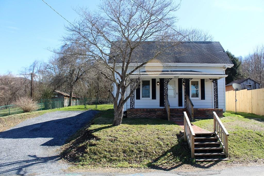 HERE'S THE CHANCE YOU'VE BEEN WAITING FOR!  WE ARE OFFERING THIS FRESHLY RENOVATED 1900'S DAMASCUS COTTAGE THAT IS CLOSE TO BOTH THE APPALACHIAN TRAIL AND THE VA CREEPER TRAIL!  SIT ON YOUR FRONT CUSTOM BRICK PORCH AND TAKE IN THE  VIEWS OF TRAIL TOWN USA DAMASCUS. ONLY 50 YARDS FROM THE VIRGINIA CREEPER TRAIL AND 3 BLOCKS FROM THE APPALACHIAN TRAIL.  HOME BOASTS A NEW 4 -CAR  GRAVEL DRIVEWAY, A NEW HEAT PUMP SYSTEM (WITH WARRANTY), A LARGE, LEVEL, FENCED-IN BACK YARD THAT BACKS UP TO TOWN OF DAMASCUS OPEN SPACE PROPERTY. REMODELED BATHROOM.  NEW PLUMBING & 200 AMP ELECTRICAL SERVICE. ALL APPLIANCES CONVEY, NEWER WASHER AND DRYER, REFRIGERATOR AND BRAND NEW RANGE. NEW WATERPROOF KITCHEN  FLOORING. HOME HAS COVERED FRONT AND BACK PORCHES AND HAS ALL NEW INSULATED WINDOWS DOWNSTAIRS.  AN AFFORDABLE INVESTMENT IN DAMASCUS THAT WOULD BE IDEAL FOR A MONEY MAKING VACATION RENTAL OR YEAR ROUND HOME. CLOSE TO SHOPPING AND EVERYTHING DAMASCUS HAS TO OFFER. OWNER/ AGENT. CALL FOR DETAILS!