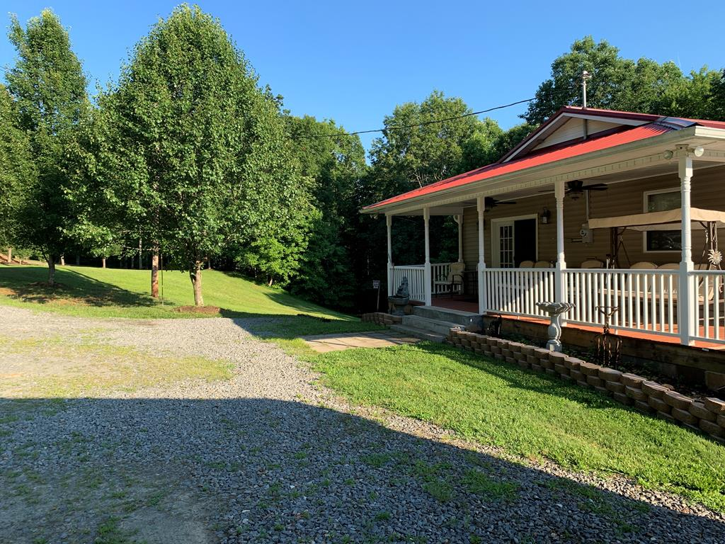 Beautiful home tucked away from the road with mountain views. This spacious 4 bed/2 bath home has plenty of room. There is a stream on the property. Be sure to check out this little piece of paradise.
