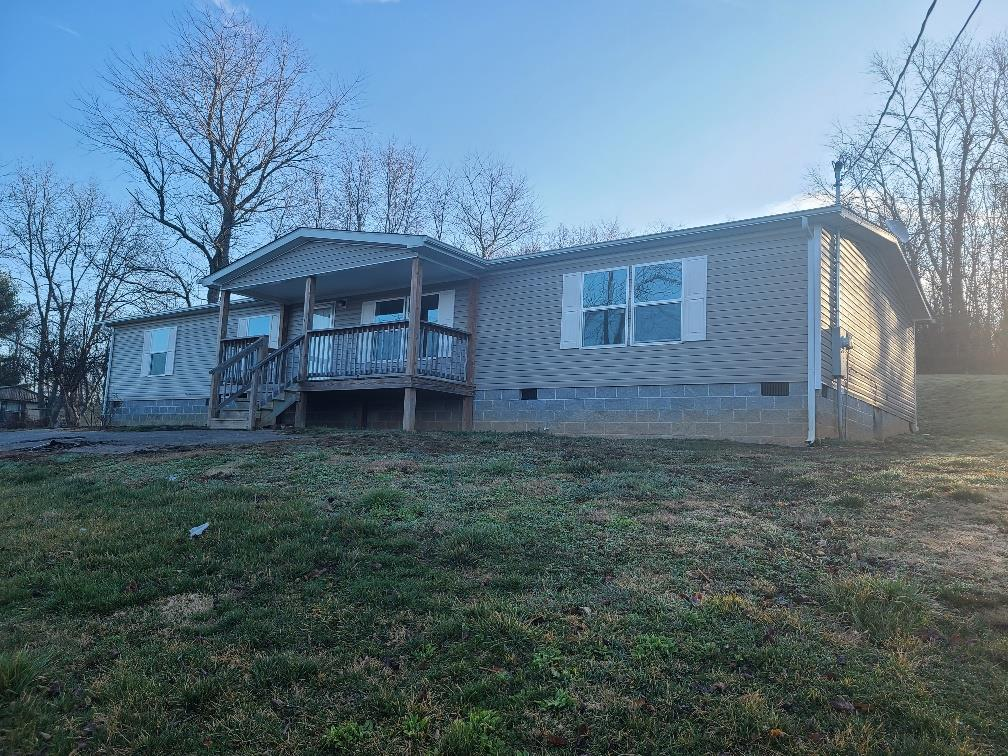 This 2016 manufactured home features a large open floor plan with cathedral ceilings and is on a permanent foundation.  New flooring and paint through out. It has 4BR and 2 Full Baths and walk in closets.