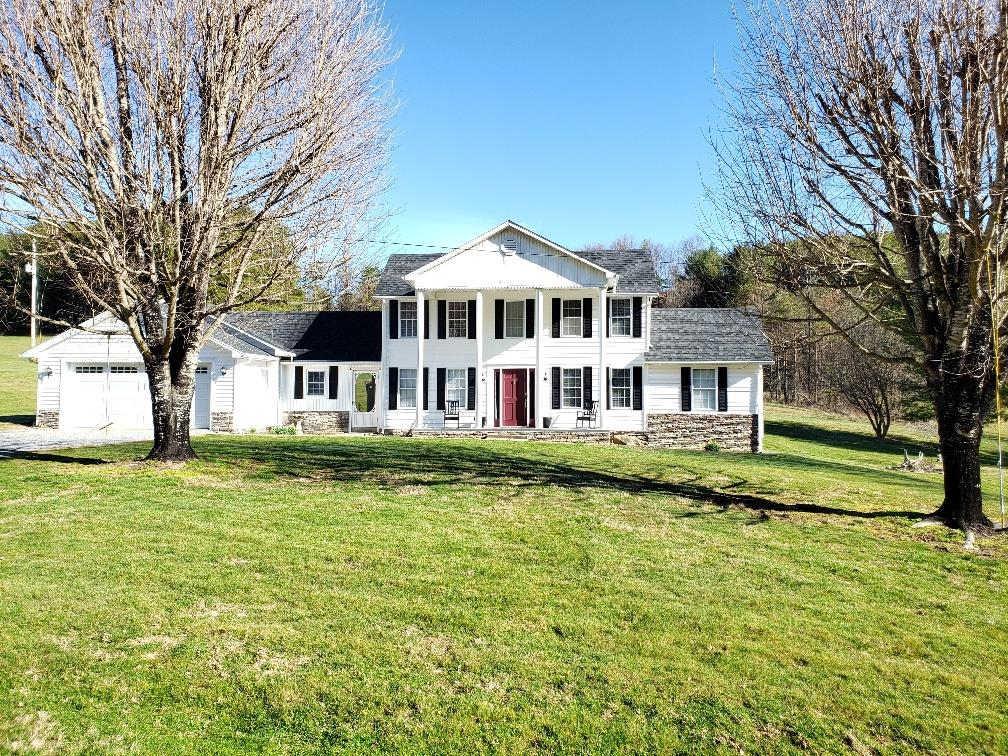 GORGEOUS COLONIAL FARM HOUSE DATES BACK TO 1930 IN GREAT CONDITION AND SITUATED ON 5.238 ACRES WITH CREEK FRONTAGE ON POWDER MILL CREEK. FEATURING 3 BEDROOM 2.5 BATH, SPACIOUS KITCHEN UPDATED IN 2018, A STUDY OFF THE ENTRANCE FOYER,  FORMAL DINING, BREAKFAST ROOM, LAUNDRY, PANTRY, SUNROOM, HARDWOOD FLOORING, HEAT PUMP, AND 2 CAR GARAGE WITH WORK SHOP. 35 X 65 BARN AND NEW 20 X 45 BUILDING PERFECT FOR YOUR RV. THE PROPERTY BORDERS A BEAUTIFUL CREEK WITH WATERFALLS AND IS PERFECT FOR A FEW HORSES. LOCATED IN CLOSE PROXIMITY TO THE JEFFERSON NATIONAL FOREST AND SOME OF THE BEST TROUT STREAMS GRAYSON COUNTY HAS TO OFFER!