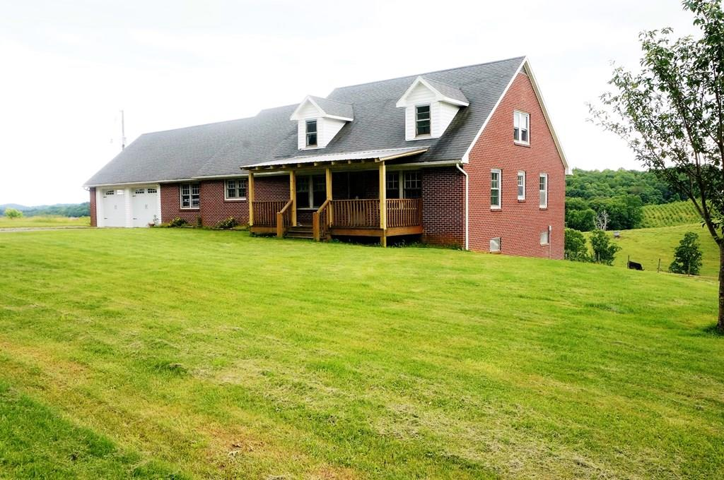 Beautiful Homestead with 35 acres of fenced pasture, small creek, huge dairy barn and  4 bedroom, and 2 bath, Brick Cape Cod with views of the countryside. This home features a huge open kitchen with ceramic tile, and all new appliances, large  Living room with fireplace, dining room, and separate den with a wood burning fireplace. The second level has two bedrooms and a bonus room that could be a fifth bedroom. New windows, new paint,new laminate flooring and  new Heat Pump for heating and cooling.   Original hardwood floors have been refinished in main living area, bedrooms and upstairs. Property has paved road frontage and driveway into the double garage. Only minutes from Main Street, Galax and the Blue Ridge Parkway.