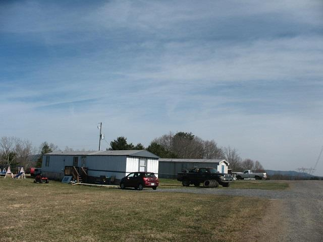 Income producing mobile home park with four trailer and one space rented out. Occupancy stays full almost all the time. Zoned commercial with plenty of space to expand with over four acres of land with public water. The trailer have been remodeled by the seller since he bought them. The vacant land behind the homes would make an excellent place to have a camp ground since the property is located close the New River, Crooked Creek (a trout stream) and all the entrainment downtown Galax including the Word's Oldest Fiddlers Convention. Seller has all income and expense figures. Chance to add to the annual income of $19,680 with an expansion.