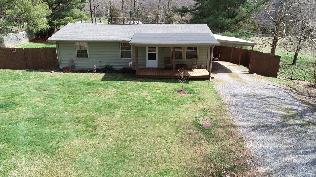 PRICED TO SELL - Completely remodeled with a newer roof,  brand new windows, new paint, new washer and dryer, new heat pump, new carport and new vinyl.  This quaint 2 bedroom, 1 full bath is located just minutes from Exit 19 and downtown Abingdon.  The master has two walk-in closets (one could be used as a small office if needed), the living room is open to the kitchen with a beautiful island for all your entertaining needs, gorgeous hardwood floors through with tile in the bathroom.  You'll love grilling and relaxing on the spacious back deck overlooking a private backyard.  Large, PRIVATE back yard with wood fence.