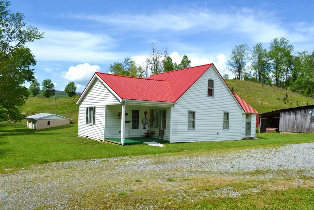 ATTENTION FARMERS, FIRST TIME HOME BUYERS, AND INVESTORS!  Take a look at this sweet 44 acre farm complete with cozy farmhouse, garage. big barn, multiple outbuildings, mountain streams, pastures, woodlands, several building sites, and lots of wildlife.  Enjoy the country life with just a short drive National Forest, The New River, Mount Rogers Recreation area, and native trout streams.  3-bedroom, 1-bath farmhouse is clean as pen and ready to move into.  Nice big barn for your animals.  2 septic systems, 2 wells. 2-car garage/workshop, open pastures for livestock, crops, or vineyard.  Serene woodlands for hunting.