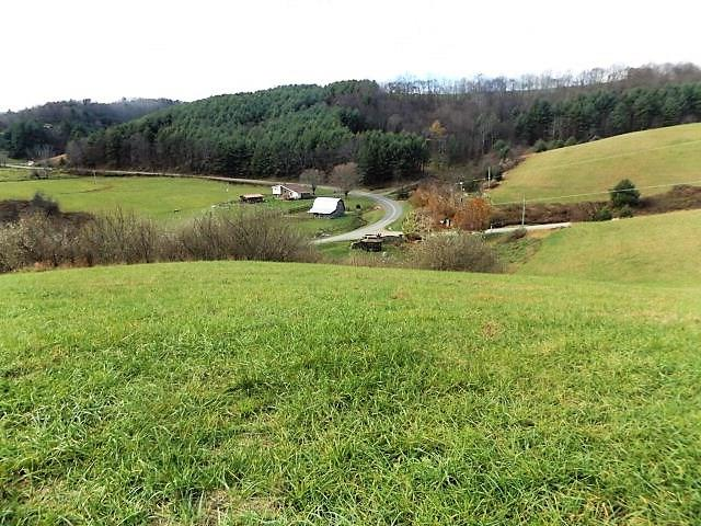 This nice 5.0622 +/- acre tract in Crooked Creek Mountain View Estates features mountainous views and fronts  the fish pond of the common area. Nice building site, paved road frontage within walking distance to the Crooked Creek Fee fishing area.  Close and convenient to Galax and Interstate 77!