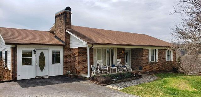 Great Location In The City of Galax! Well maintained brick ranch home featuring 4 bedroom and 2 bath. Brick fireplace in the living room, Den, hardwood & tile flooring. Partially finished basement with bedroom and bath. Heat pump, Covered back deck and paved driveway.