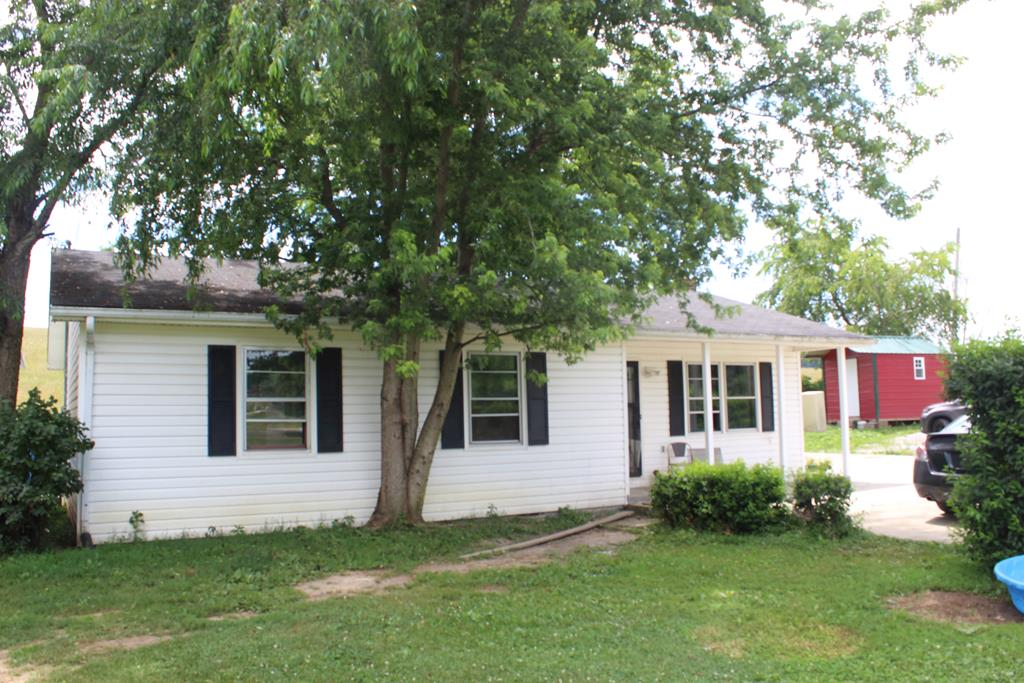 Cute ranch home with 3 bedrooms and 2 baths on an acre of land.  Don't let the sellers packing up distract you from the homes good bones, easy layout and flat yard with 2 peach trees perfect for your summer entertaining!!!  Seller has purchased new kitchen cabinets however they have not been installed - check out the design on the large pantry cabinet which we have left out for you to see. New cabinets are not currently included in the price - feel free to negotiate them!