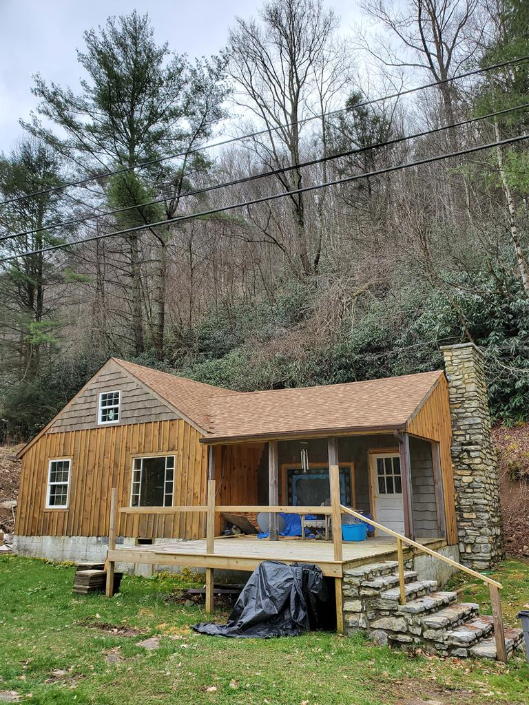 Great for a get away home in the heart of the Mount Rodgers recreational area of Whitetop Mountain. Visitors come from around the country for biking, hiking, fishing, hunting and just to view the breathtaking mountains and foliage. Finish  This property Your way, it Could be ideal for investors for a seasonal or full time rental.  This property is a renovation in progress. The cottage is a rustic style home framed for 3 bedrooms and 1 bath. The exterior is mostly finished with a new roof, wood siding and insulated windows. The living room is mostly finished with stone fireplace and antique mantle. The rest of the house is in various stages of renovations. There are no bath or kitchen fixtures. There is a well but no water lines nor septic installed. A dated septic permit is in the file. All building materials on site are negotiable