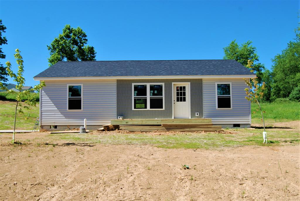 Very nice one level new construction home with 3 bedrooms, 2 baths, 8 ft. ceilings, laminate & carpet flooring. This home will offer brand new appliances, island/bar in kitchen, recessed lighting, ceiling fans throughout, covered porch and open deck for outside entertaining.  The 1 acre lot  allows plenty of room for the pets to roam or the children to play. Home is located near schools, shopping and other town amenities. Seller has allowances in place and any upgrades prior to completion will change the price of the home.  Taxes are for vacant lot prior to construction. New taxes will be determined after completion. Don't miss out on this Brand New Home...call and make an appointment today!