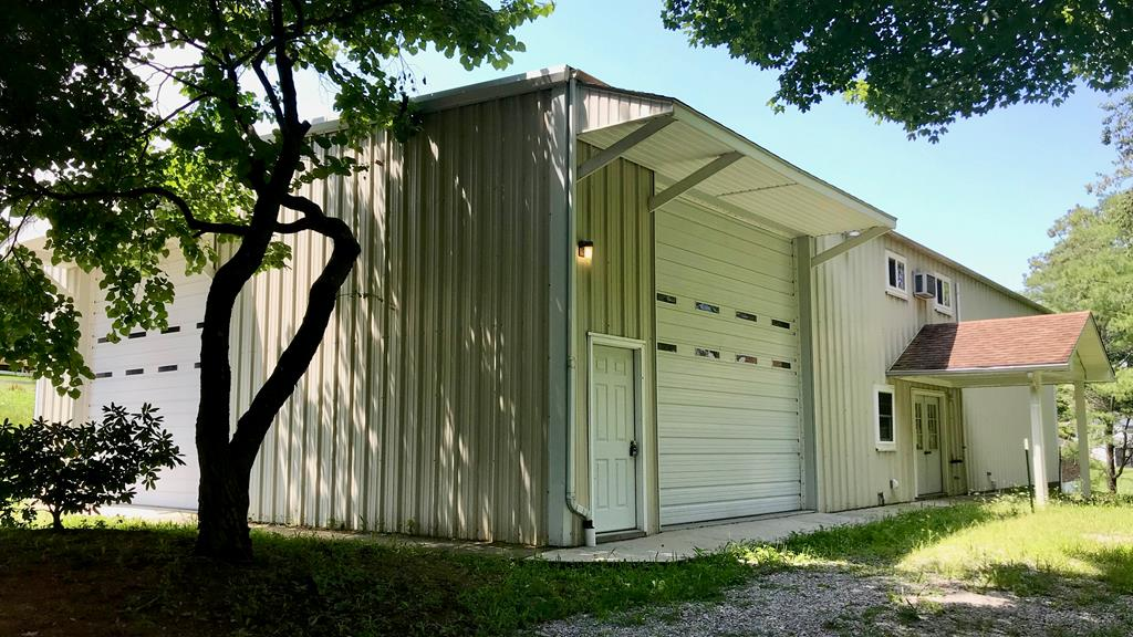 2.3+ acres with multi-family development potential in the town of Rural Retreat. The 40' x 75' multi-purpose building is full of surprises. Offered fully furnished, the main feature is the two bedroom, two bath living quarters with new kitchen/appliances, bedrooms, upstairs bath, and flooring awaiting you inside. The building also provides storage and hookups for multiple RVs and a 30' x 15' indoor pool. Professionally landscaped with an abundance of fruit trees, bushes, flowers, and garden spots all wrapped by ~1,600 feet of maintenance-free vinyl fencing. It's a perfect oasis in the heart of the welcoming town of Rural Retreat. This park-like setting is perfect for entertaining large family gatherings or it can be developed into a property that can accommodate more permanent guests via single or multi-family housing. The choice is yours. NEW HEAT PUMP INSTALLED SEPTEMBER, 2019. New furnishings in 2020.