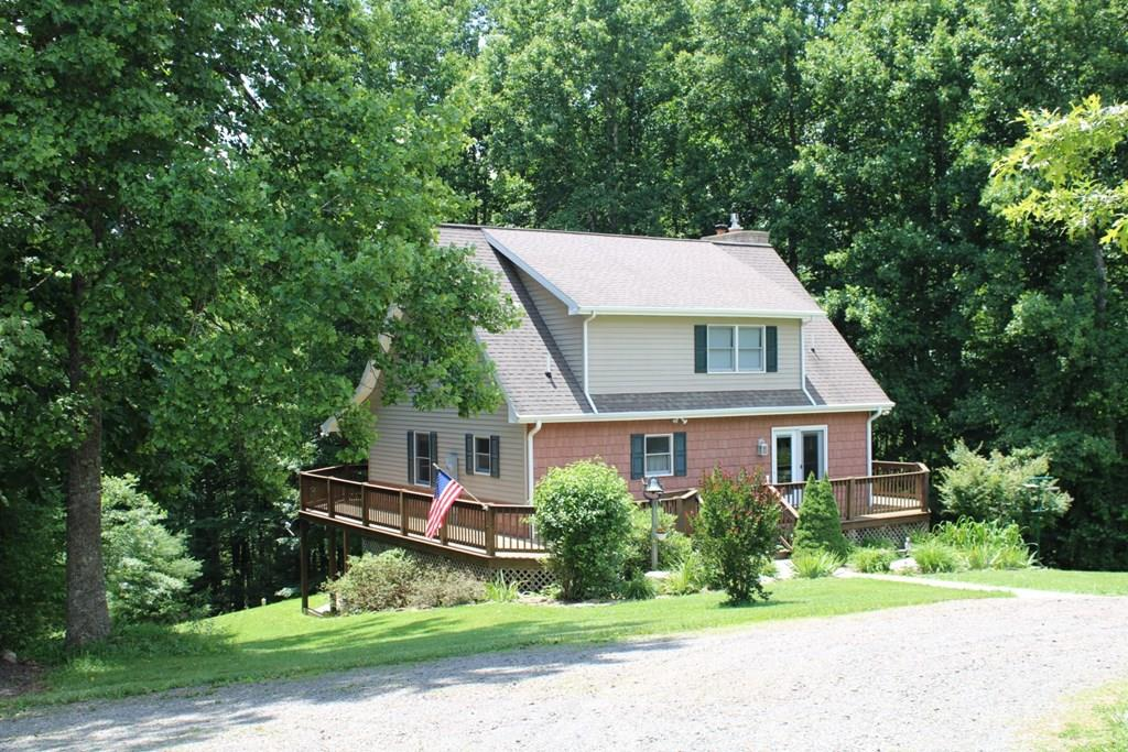 Exceptional home with 10+ Acres adjoining the Crooked Creek Wildlife Management Area. Property features: 10+ acres with 180 white pines and 40 red oaks throughout property. Walking trails down to the creek and spring. Fenced raised garden beds, blueberry patch, peach & apple trees. Horse shoes and fire pit area for recreation. 936 sq' ft' two car detached garage with a workshop that has water, air and a lean to. Bring your camper for a complete hookup with water, sewer and 50 amp electric. Wood shed has a covered concrete area to sit and enjoy the cool breezes and  a place to park your car, tractor and lawnmower. Home features: 2610 sq. ft., 3  Bedrooms, 3.5 Baths. Main level has a  living room with hardwood floors and floor to ceiling stone gas log fireplace, kitchen with tile and Corian counter tops, master bedroom with hardwood flooring, master bath with cultured marble shower and flooring, double sinks & spacious cabinets, half bath with closets and laundry.