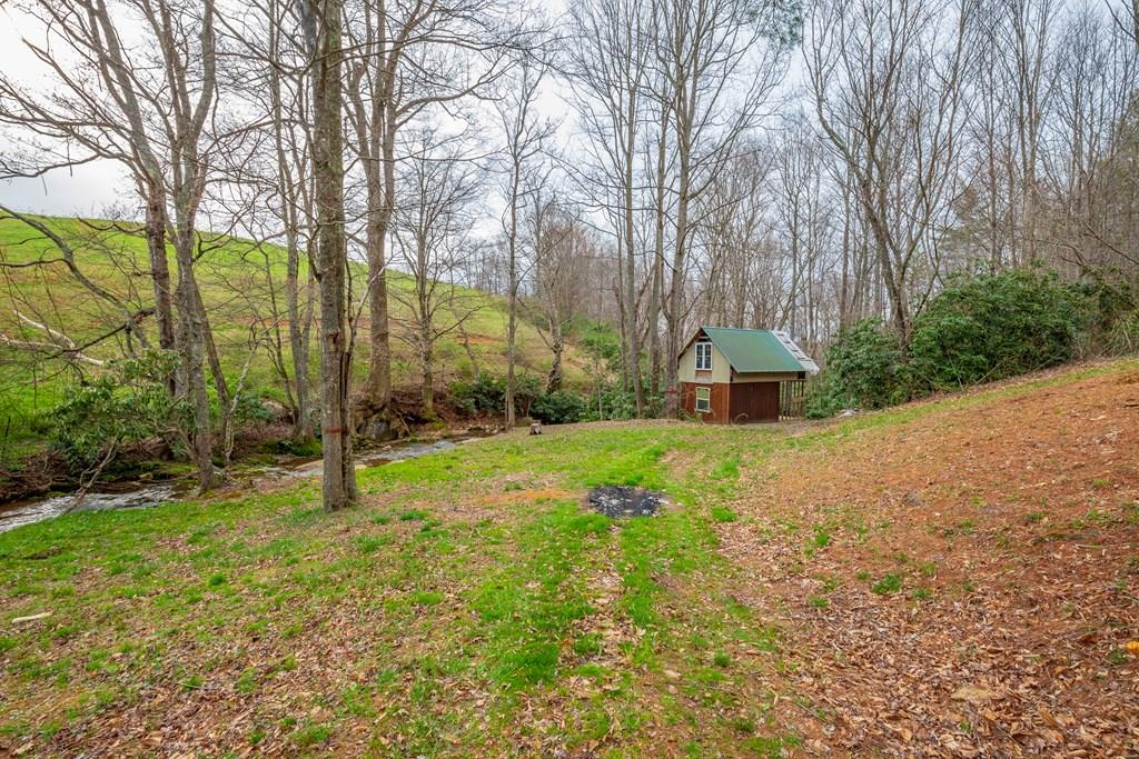This beautiful 3 acre mountain property has a lot to offer! A relaxing creek winds through the property, and an unfinished hunting cabin is ready for you to make it your own. A spring for water means this is the perfect property for your mountain getaway or a secluded home. It is priced to sell and it wont last long. Schedule a showing today!