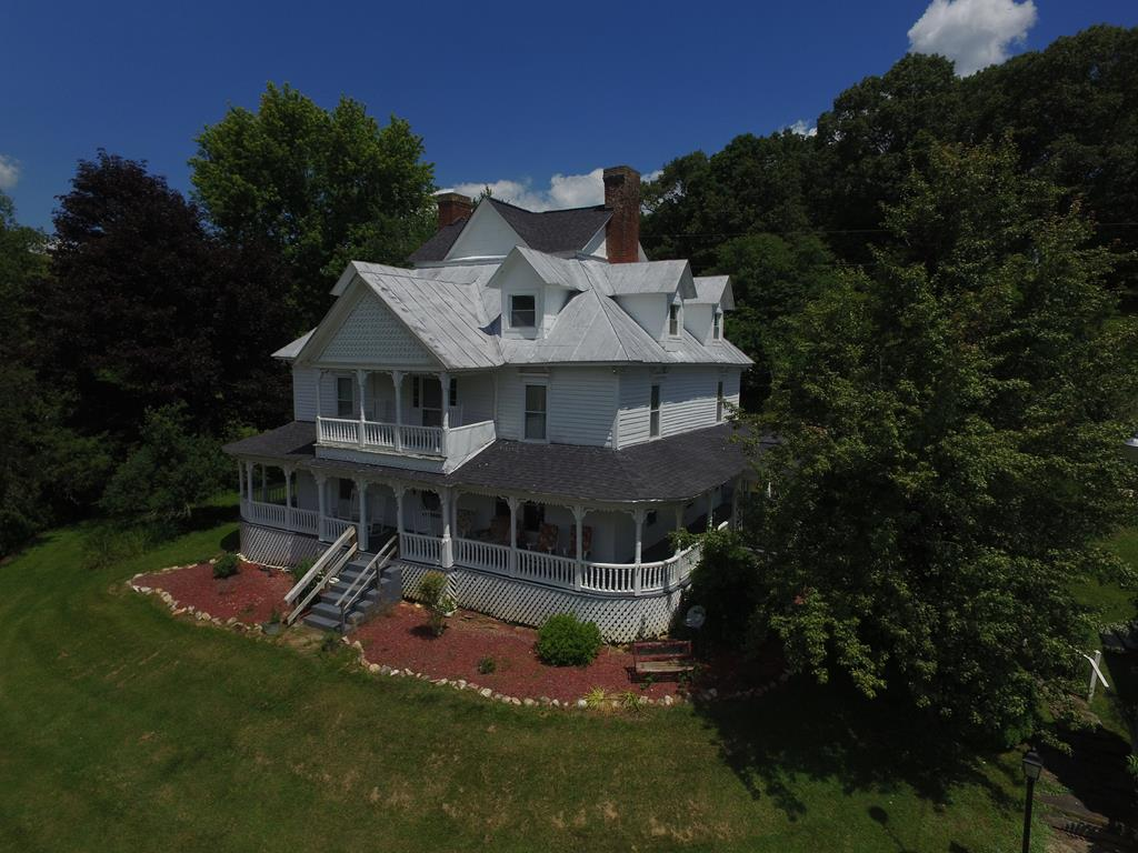 HISTORIC HOME in Grayson County!  This majestic home was built in 1888 and still today has a lot of its' original charm. The home has been completed restored while offering you a glimpse back in time!  Appreciate the history by walking on original hardwood flooring, climbing the glamorous staircase,  ship-lap on the walls, wrap around porch, beautiful balcony, original fireplaces and doors, and so much more. The electrical system has been completed updated along with the windows, plumbing, and HVAC system installed. Terraced area for planting, restored corn crib, hay barn,work shop, spring fed pond full of fish, all located on 5 acres.