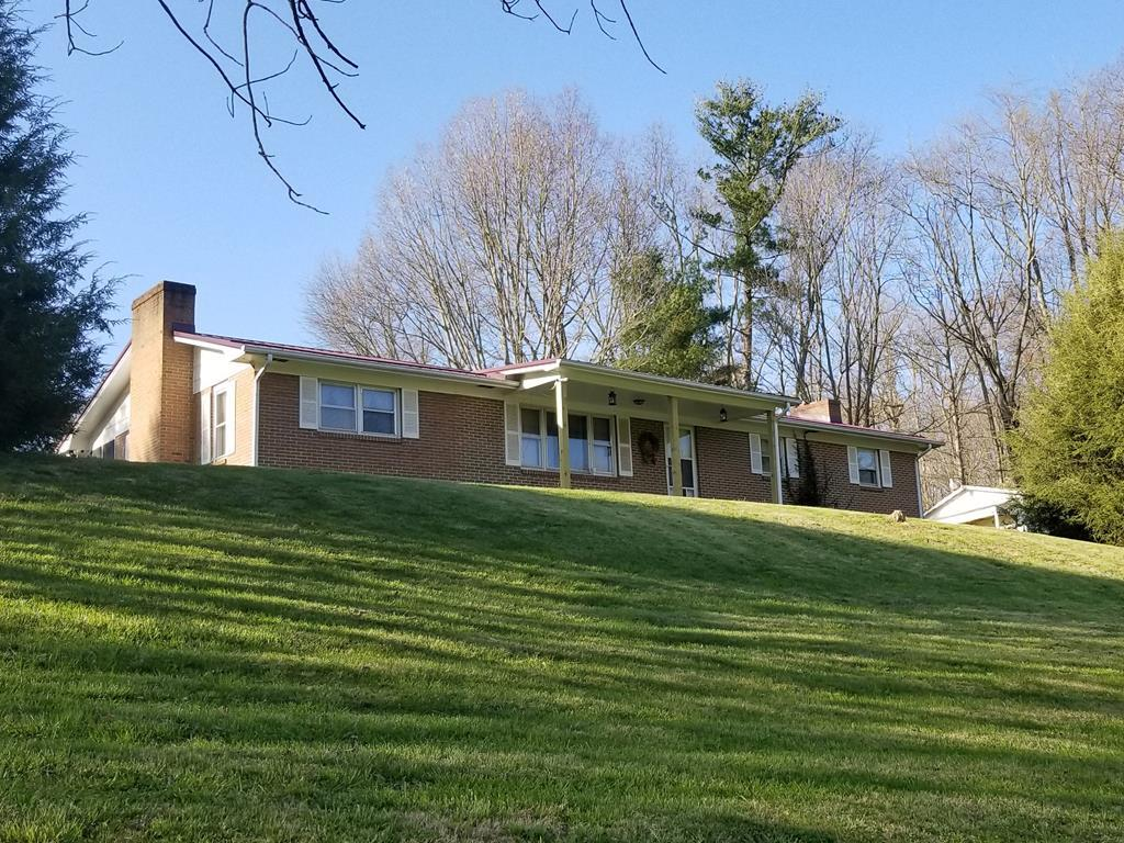 A full $30,000 below tax assessment!!!  Located in Washington County.  Furniture in den will convey unless purchaser wants it removed.  New metal roof installed in 2016.  Trane heat pump installed in July 2019.  There is a window unit A/C unit in the master bedroom (for additional cooling in that room) which will convey unless purchaser wants it removed.  Replaced water line from meter base to house with PEX pipe.  Wood burning fire place in den.  Wood burning fireplace in basement.  Also has Heat Blast wood furnace piped into heating system.  Owner has taken care of several operational upgrades, now you can bring your creativity and add some cosmetic touches  to turn this into your dream house.