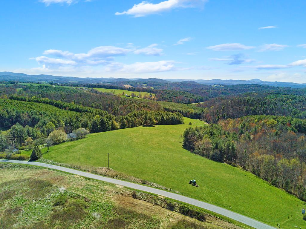 One of a kind! Build up on top for a 360 degree view, and with a bold stream at the bottom of the property! Ideal for horses, and a great mowing field! It has all the privacy of being out in the country, but is still convenient to both I-81 and I-77, and within an hour of Blacksburg,Roanoke, Floyd, Christiansburg, Hillsville, Radford, or Wytheville. Call today to come see why this property should be yours, and be sure to watch a video description of it on Youtube at..... https://www.youtube.com/watch?v=HxBa0aIZW1I