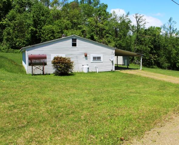 45.73 acres  -  Basement home with 2 bedrooms, 1 bath and kitchen dining room living room combo.  Laundry area is in bathroom. Land is rolling. Good Timber. Approximately 15 acres open and remainder wooded.  Fronts on State Paved road for approx. 500 ft.. Views of Surrounding area. Stream running thru middle of property going thru pond area.  On property is a 1-2 ac pond where the  stand pipe has deteriorated at the bottom of pond. Pond needs to be reworked and cleaned out and drained before bringing it back to original size.   Abundant wildlife-hunting. You could build on top of the basement home.  Several great building sites. Property is located at higher elevation.  This property has it all views, road frontage, great building sites, stream, abundant wildlife and pond. 5 minutes to North Entrance to Primland Resort. 10 minutes to Meadows of Dan and Blue Ridge Parkway. 20 minutes to Stuart, VA..  35 minutes to Floyd, VA.  40 minutes to Mt. Airy, NC.