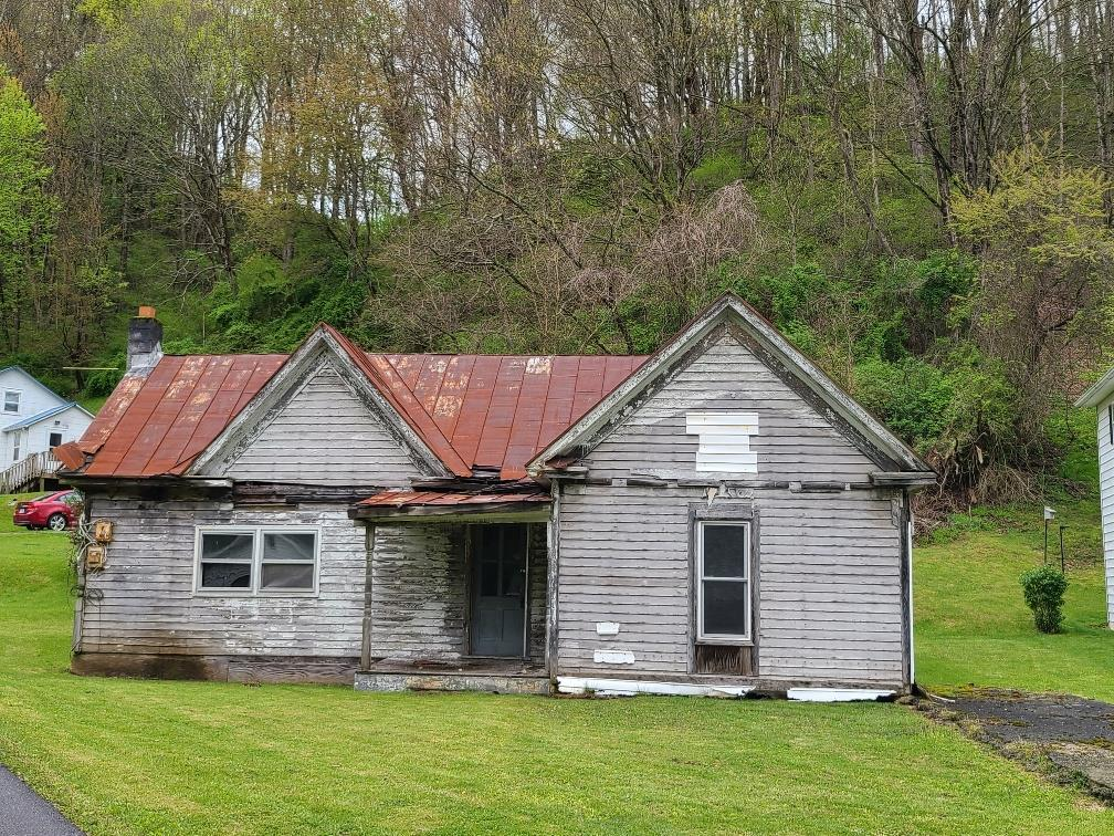 """Lot available in town limits of Marion.  Some level in the front and mountain to the rear.  Older dwelling of no value on the property.  Building inspector to tell buyer or buyers agent if it is fixable.  Property sold """"as is, where is"""" with no warranties or guarantees. Town zoning restrictions to apply."""