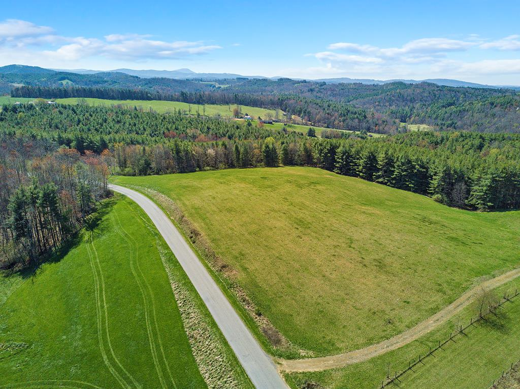 This 13 ac property is a little piece of heaven located right here in the New River Valley. Beautiful views on top where you could build a house and enjoy the sunrise and sunset. Approx five acres are cleared and have been used for a hayfield, and 8 acres wooded, with 340' of creek frontage. Add some fencing and it would be a great property to keep horses. Very private and out in the country, yet very convenient to Blacksburg, Radford, Floyd, Christiansburg, and even Roanoke. It's almost impossible to find a property this great for less than $100,000 so come on out and see if this is the right piece of land for you!