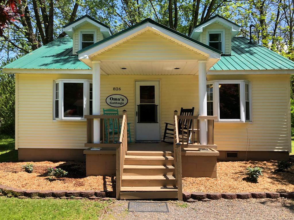 Oma's Cottage! This very popular vacation rental is located in the heart of Damascus, Virginia. The four bedroom, one bathroom home is being sold completely furnished for a seamless turn key transition. Also included in the sale of this property is the business website, omascottage.us. Recent updates to the home include a new metal roof and heat pump. This home is conveniently located within walking distance to the Appalachian Trail, the Virginia Creeper Trail, the Damascus town park, community library, community swimming pool and downtown Damascus. Whether you are looking to operate a vacation rental or purchase a home in Damascus for your own residence Oma's Cottage is definitely a must see!