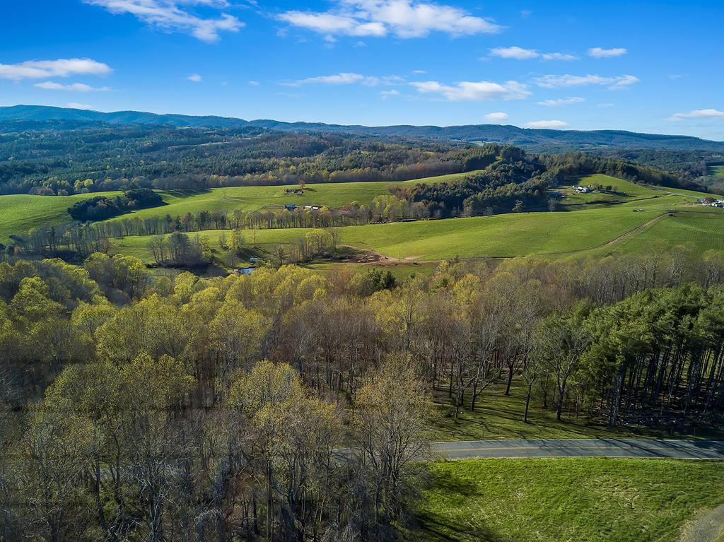 Enjoy the peaceful country setting and beautiful sunset views on this 12 ac property in Floyd County. There is a spring on this property, and it is fenced for cattle (currently has cattle grazing on it). It's divided into two tracts, and has great building sites on both! You can be to the Blacksburg/Christiansburg area in just 30 minutes, or Floyd or Hillsville in just 25, making it convenient for wherever you need togo, while still being able to live in a rural setting. Would make an excellent location to build a house and plenty of room to keep animals.Come check it out today!