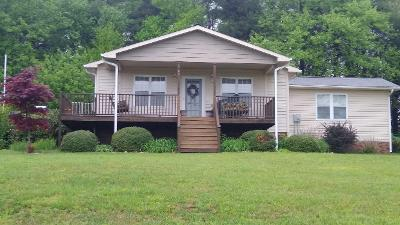 VERY NICE 3 BEDROOM, 2 BATH MOSTLY FURNISHED HOME IN A SUPER COMMUNITY JUST OFF THE BLUE RIDGE PARKWAY.. ENJOY THE COVERED FRONT PORCH WITH PEEK-A-BOO PIEDMONT VIEW OR BBQ ON YOUR LARGE SIDE DECK.  THE MASTER BEDROOM & BATH ARE A NEWER ADDITION (2012) TO THIS PROPERTY. RE;AX TO YOUR HEARTS CONTENT ON THE PORCH OR YARD SWINGS. .THIS IS A WIDE OPEN GREAT ROOM PLAN  WITH GAS LOG FIREPLACE. ALL APPLIANCES STAY INCLUDING WASHER AND DRYER. STEPSAVER KITCHEN & BREAKFAST  BAR WITH 4 BAR CHAIRS. PAVED DRIVE. COMMUNITY AMENITIES INCLUDE POOL, CLUBHOUSE, GAZEBO, FISHING PONDS, TENNIS & PICKLEBALL COURTS. LOW ANNUAL HOA FEE  IS $455 PER YEAR AND INCLUDES COMMUNITY WATER & TRASH. WATCH THE DEER AS THEY GRAZE UNDER YOUR APPLE TREES. EXCELLENT PIEDMONT VIEWS FROM MANY LOCATIONS. CURRENTLY SERVICED BY CENTURY LINK INTERNET. BUYER TO VERIFY AVAILABILITY. PROPERTY ADJOINS BLUE RIDGE PARKWAY. 5 MINUTES TO FANCY GAP, 25 MINUTES TO MT AIRY OR GALAX.