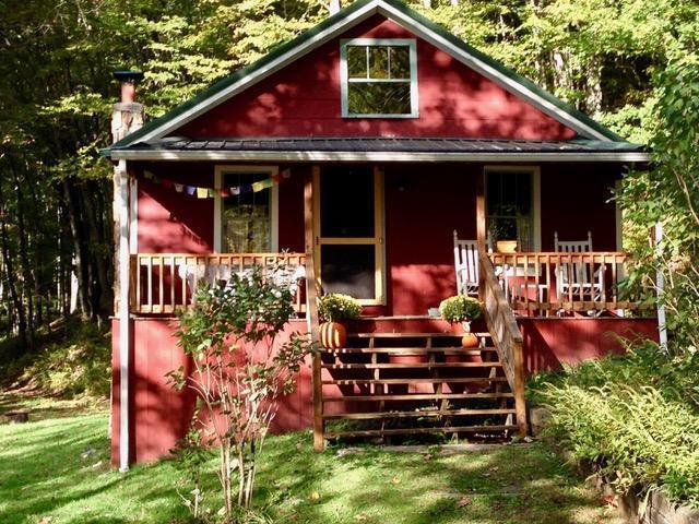 Cozy mountain cabin with big acreage for the OUTDOORSMAN (and Woman)!!! 43.2 Ac Wrapped on 3 sides by Jefferson National Forest. Perfect place to get away to the mountains and enjoy everything nature has to offer. This charming and cozy red mountain cottage was originally built @1940 and was beautifully renovated and restored in 2005. Inside, youll find original windows and hardwood floors complemented by wood plank walls and ceilings and a working wood stove. The private, mostly wooded tract is just the thing if you like to hike, mountain bike, horseback ride, fish, hunt, or just relax in the rocking chairs on the front porch or on the large back deck and enjoy the peace and quiet. Superb seasonal views of the surrounding farms and mountains make this the ideal Mountain Retreat! Hike the trails by the cascading creek, with noisy little waterfalls, into the National Forest, where you can access endless further trails into the Little Wilson Creek Wilderness Area.