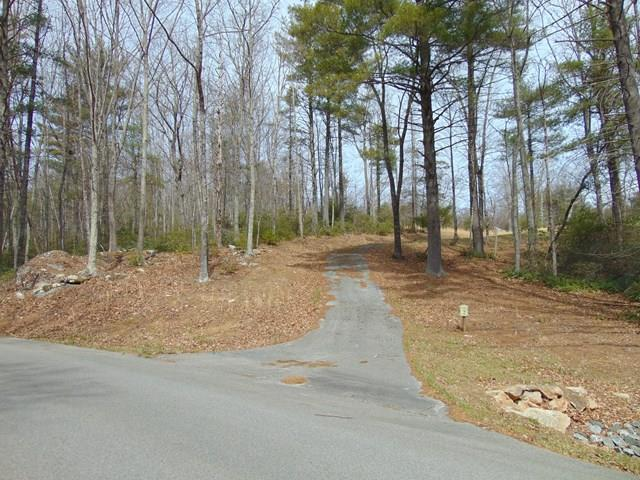Beautiful Private lot with mountain views in an outstanding gated community in Grayson County.  Paved roads and a paved drive lead into this rolling lot surrounded by mature hardwoods and rock outcroppings, making the lot private and complimentary to the natural topography.  Underground utilities are already on site and a cold mountain creek runs through the property, a great place for a picnic!    The lot rises up above the road with stands of hardwoods surrounding the cleared center making this building site very private but easy to get in & out of the community in all weather.  Sloping upwards, your building site has fabulous mountain views!  The restrictive covenants and an established HOA protect your real estate investment in Pine Mountain estates, a thoughtfully planned, well cared for, gated community in Grayson county.  Shop, compare and make an appointment today to visit Pine Mountain Estates to see this beautiful mountain lot & begin building the next chapter in your life!