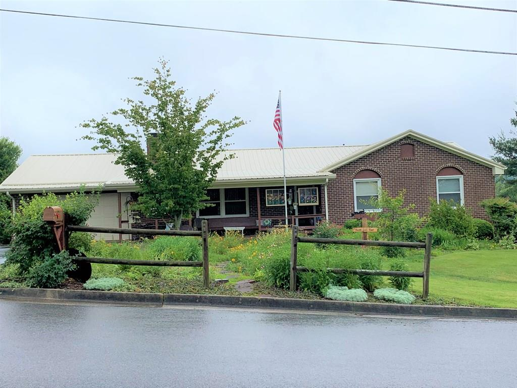 Gorgeous 3 BR 2 BA brick ranch home near the golf course! This home has had many updates, including but not limited to: new roof, remodeled kitchen, new windows, remodeled bathrooms, new flooring, new plumbing throughout, new 200 amp electrical box, new water heater, and new paint in every room. Beautiful large sunroom addition with vaulted ceilings was added in 1990. Large master suite with tiled shower and flooring. Downstairs is a family room with a fireplace, as well as a nice workshop and craft room with lots of storage. Outside you will find a covered front porch, open back deck, and nice covered patio off the sunroom. Nice large lot with fenced in backyard, perfect for kids or pets. Outside utility sink and nice raised garden bed area, chicken coop, gazebo, and outbuilding. Drive-under and attached garage. Paved driveway and beautiful landscaping! All this in a great location close to the golf course and Emory & Henry School of Sciences! Make your appointment before it's gone!