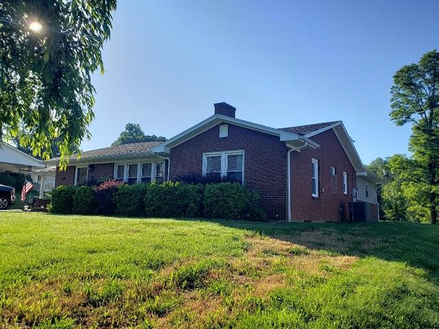 Great location in Galax City! Nice 3 bedroom 2 bath featuring hardwood floors, spacious kitchen, living room with gas log fireplace and recess lighting, central heat and air, full basement, new out building, and concrete patio and carport. Close to shopping, schools and hospital.