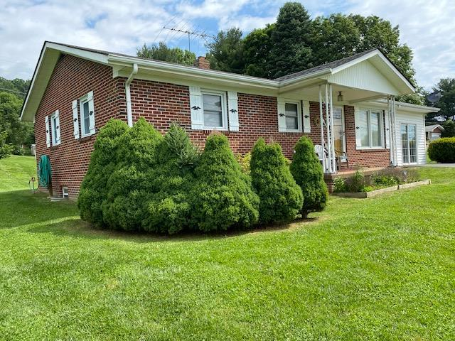 Very well kelp one owner brick ranch on a nice level lot. Home has carpet with hardwood floors underneath (believed to be in good condition), Large family room with fireplace,  26X11 rec room in basement, extra thick insulated tilt windows, appliances, oversized detached garage with electric, 14X9 workshop (man cave) also with electric, covered front porch, covered and open deck. Water conditioner is owned not rented. Heat pump and water heater are not very old. One level living at its best. This is a great home for the money.