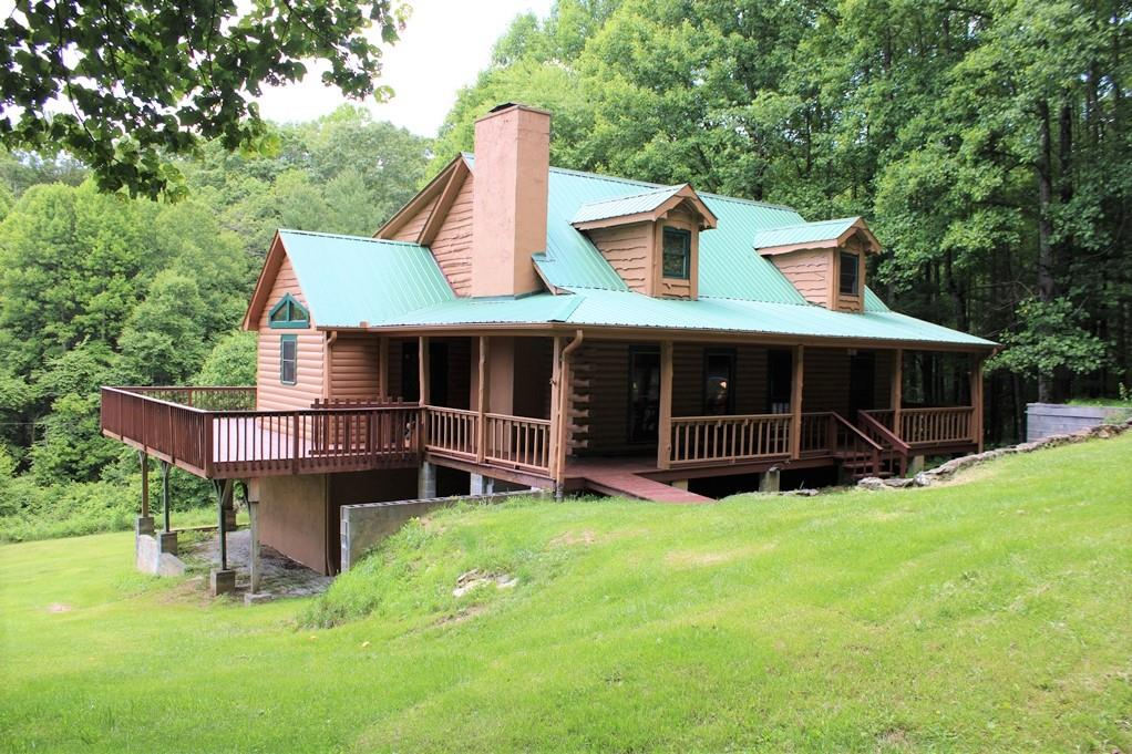 Spacious log home in Cascade Mtn Resort. Home features: 1741 sq. ft, 3 BR, 3 BA, Wood burning fireplace, All hardwood flooring, Kitchen has lots of cabinets and all appliances convey, You can walk out to the back wrap around 818 sq. ft. deck, Living room, kitchen, dining area, bath and 2 rooms for bedrooms on main level, Upstairs you have a spacious loft, bedroom and bath. Floors are 2 x 6 tongue groove. Back up propane generator. Basement is already sectioned off for easy finishing.  Land features: 3 lots total with a lot on each side of home for privacy. 10'X12' Outbuilding. Home is located in a gated community. Amenities include: Pool, Tennis courts, Fishing pond, Clubhouse, Common areas, Playground, Trash area, Community water.