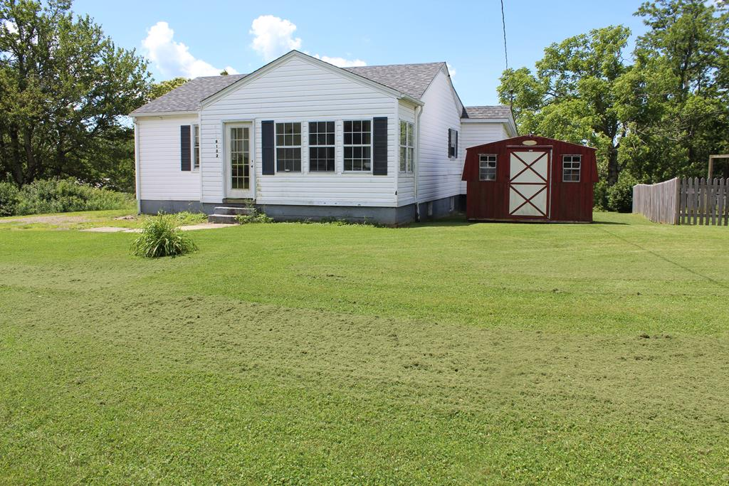 """Cottage Style Home located in Patrick County, Virginia (6132 Jeb Stuart Highway, Meadows of Dan, VA 24120). This is a fixer-upper. Fronts on State Paved Road. Main Level: Sun room ( 5'6"""" x 18'). Living Room ( 11' 4"""" x 16' ). Full Bath (8' x 6'4""""). Bedroom (11'6: X 10'6""""). Bedroom (9'6"""" x 11'6""""). Kitchen (10' x 11'4). No appliance in the kitchen.Family Room (9'9"""" x 13'8""""). Off Family Room bonus room (9' x 7') this room has door to back yard. Unfinished basement. 5 minutes to Meadows of Dan, VA and the Blue Ridge Parkway. 5 minutes to North Entrance to Primland Resort. 15 minutes to Stuart, VA. 30 minutes to Floyd, VA. 30 minutes to Mt. Airy, NC."""