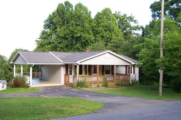 Enjoy the clean air, beautiful trees and lovely view from the back deck on this ranch located between GALAX and HILLSVILLE.  You will thank the owner for the maintenance and care given to the home and property.  2 bedrooms with one large enough for a king bed and large furniture.  The basement is walk out, plumbed for another bath, very nice epoxy floor finish. There a flue if you would like to have a wood stove in the basement.  Outbuildings, a real clothes line, beautiful trees and flowers. You will be impressed from the moment you drive up. There is no thru traffic, located just minutes from Rt. 58, and I-77.